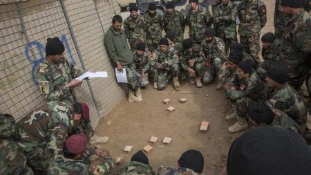 Afghan Army Commandos listen to OPORD briefing
