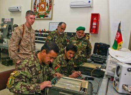 Communications advisor assists ANA 215th Corps communicators with radio repair.