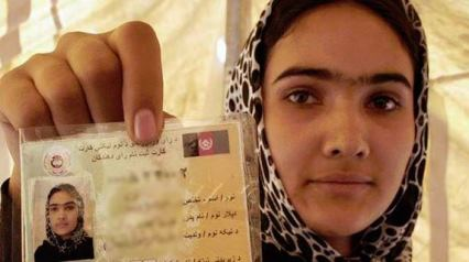 Afghan woman with voter card April 2014 election